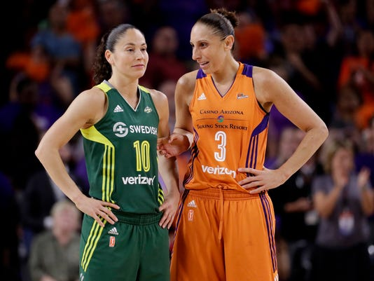 FILE - In this Sept. 6, 2017 file photo, Phoenix Mercury guard Diana Taurasi (3) talks with Seattle Storm guard Sue Bird (10) during the second half of a single-game WNBA basketball playoff matchup, in Tempe, Ariz. Bird and Taurasi headline the 29 players chosen for the U.S. women's basketball team pool. Eleven members of the 2016 Olympic team that won a sixth consecutive gold medal for the Americans are in the pool that was announced Thursday, Dec. 14. (AP Photo/Matt York, File)