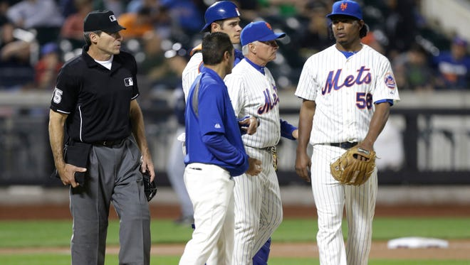 Mets relief pitcher Jenrry Mejia (58) leaves during the 11th inning of a baseball game against the Milwaukee Brewers, Thursday, June 12, 2014, in New York.