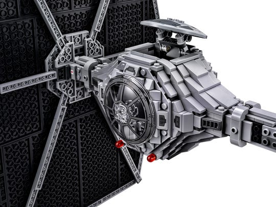 The collector's TIE Fighter includes an opening top