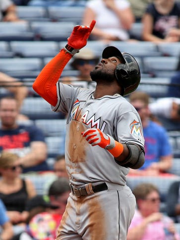 Marcell Ozuna hits a two-run home run for the Marlins.