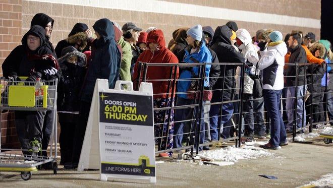 Shoppers wait for Best Buy in Kohler to open for Black Friday specials back in 2013.