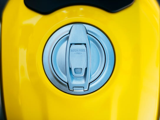 The gas cap is inscribed with the words Born Free 1962,