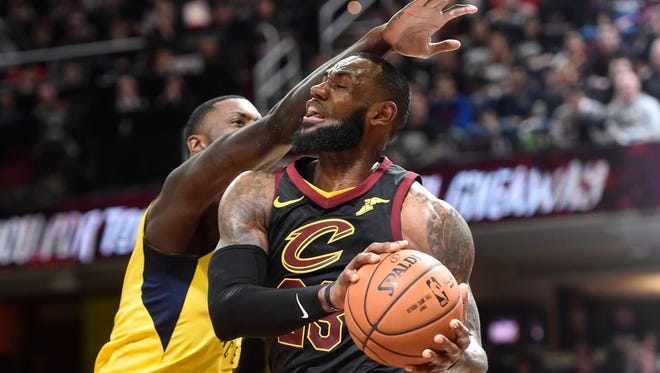 April 15: LeBron James is fouled by Lance Stephenson during Game 1.