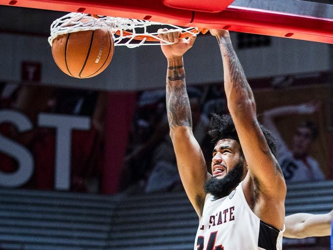Ball State's Trey Moses dunks against Buffalo's defense