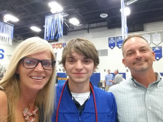 Jaycob Dexter Pearson, center, with his mother, Jenn Nelson, and father, Jim Pearson, during his graduation this spring. Jaycob died tragically this fall, and his family has set up a scholarship in his name.