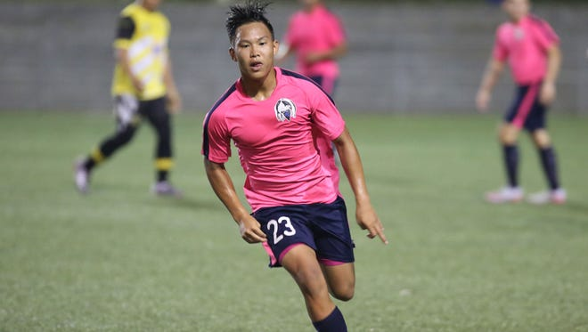 Lots of Art Heat's Austin Rioja focuses on the ball as he makes his way through the midfield in a Budweiser Men's Soccer One League regular season match against Bobcat Rovers in this file photo taken at Guam Football Association National Training Center.