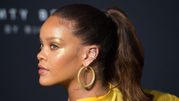 Rihanna arrives to celebrate the launch of her beauty