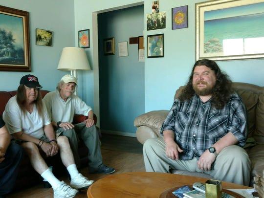 Dann's House residents in the living room, left to