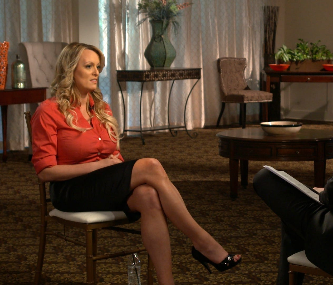 This image released by CBS News shows Stormy Daniels, left, during an interview with Anderson Cooper, scheduled to air Sunday on