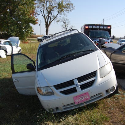 Four people were injured in a three-vehicle crash on