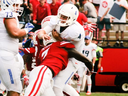 UL's Otha Peters, shown here hitting Boise State quarterback