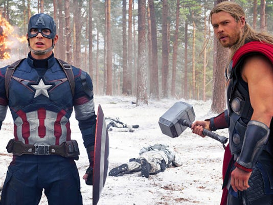 "This photo provided by Disney/Marvel shows Chris Evans, left, as Captain America/Steve Rogers, and Chris Hemsworth as Thor in a scene from ""Avengers: Age Of Ultron."""