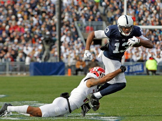 Penn State's Saeed Blacknall (13) is tackled by Rutgers' Isaiah Wharton (11) after a catch during the second half of an NCAA college football game in State College, Pa., Saturday, Nov. 11, 2017. Penn State 35-6. (AP Photo/Chris Knight)