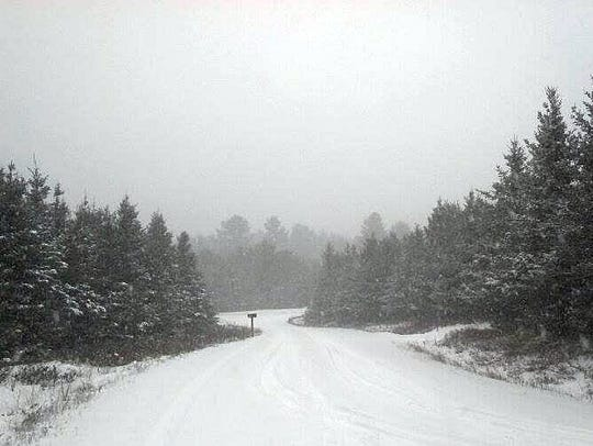 Snow falls southwest of Rhinelander as the first winter