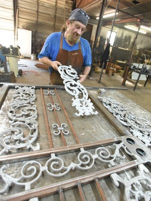 James Nolen of Security Fence and Iron, Inc. lays out the pieces for a custom door.