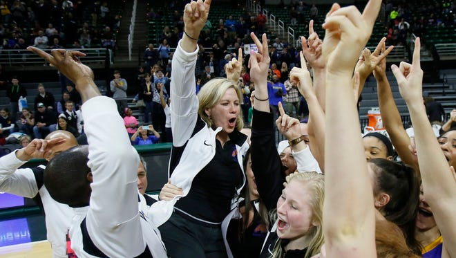 Bloomfield Hills Marian players and coaches celebrate after their 51-37 win over Dewitt in MHSAA Class A girls basketball final on Saturday, March 21, 2015 in East Lansing.