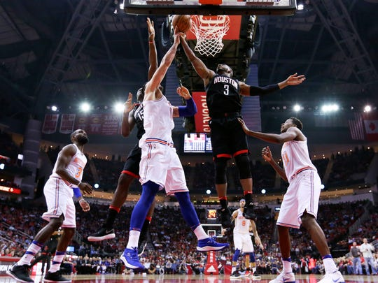 Houston Rockets guard Chris Paul (3) goes up for a