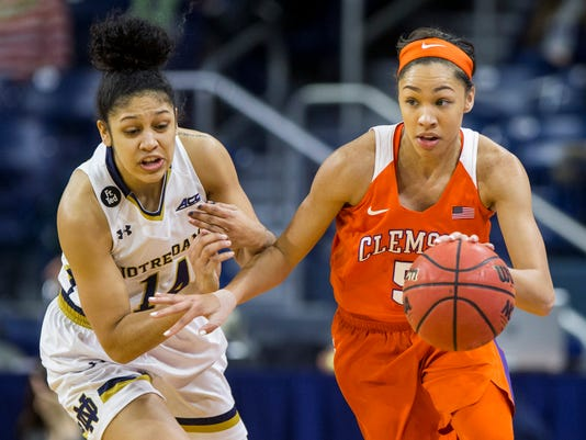 Clemson's Danielle Edwards (5) drives next to Notre Dame's Mychal Johnson (14) during the first half of an NCAA college basketball game Thursday, Feb. 25, 2016, in South Bend, Ind. (AP Photo/Robert Franklin)