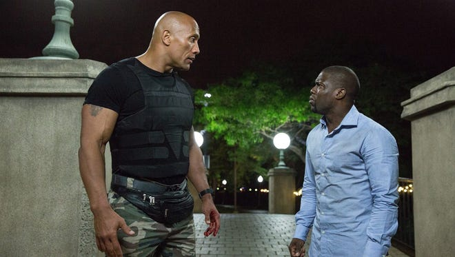"""Dwayne Johnson and Kevin Hart are mismatched allies in a CIA caper in the comedy """"Central Intelligence."""""""