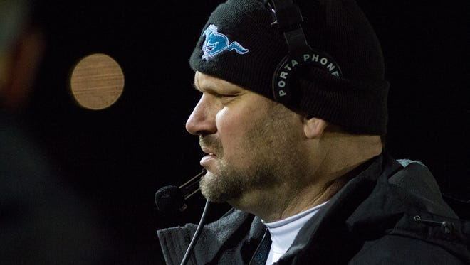 North Oldham head coach, Billy Martin, reacts while playing Owensboro during the 2014 Class 4A Semi-State Championship. November 28, 2014.