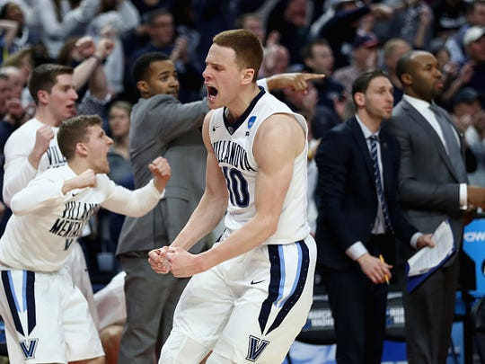 Villanova's Donte DiVincenzo reacts after a shot against Wisconsin during the second round of the 2017 NCAA Men's Basketball Tournament.