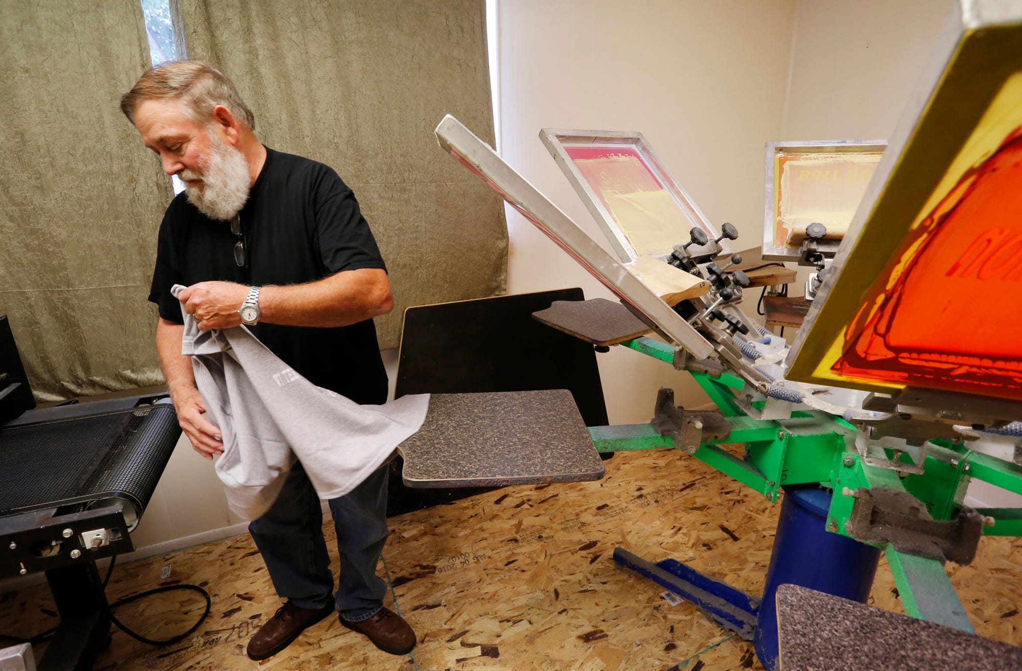 Charmant Owner Dick Mullen Removes A Custom T Shirt From A Six