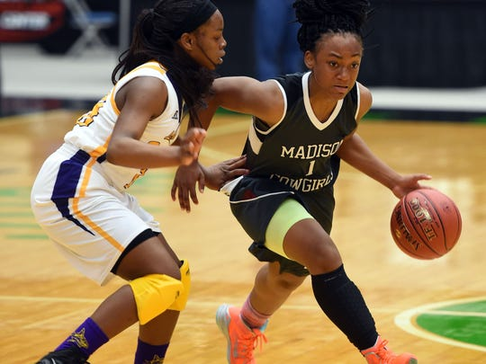 Madison County's Tamiera Mobley (1) dribbles around Port St. Joe's Jaira Patterson (10) during their class 1A semifinal in the FHSAA Girls Basketball Finals at The Lakeland Center in Lakeland, FL on Tuesday February 16, 2016. Madison County defeated Port St. Joe 53-48 to advance to the final.