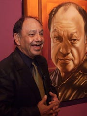 Cheech Marin speaks to guests at the opening of a previous Chicano art exhibit featuring some of his collection inside the El Paso Museum of Art.