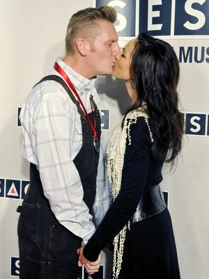 Rory Feek kisses his wife, Joey Martin Feek, on the red carpet at the SESAC Nashville Music Awards on Nov. 7, 2011.