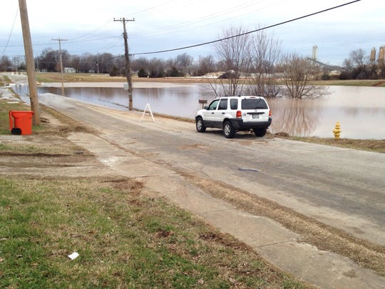 A section of 30 to 40 yards of West Calhoun Street was still flooded Wednesday morning.
