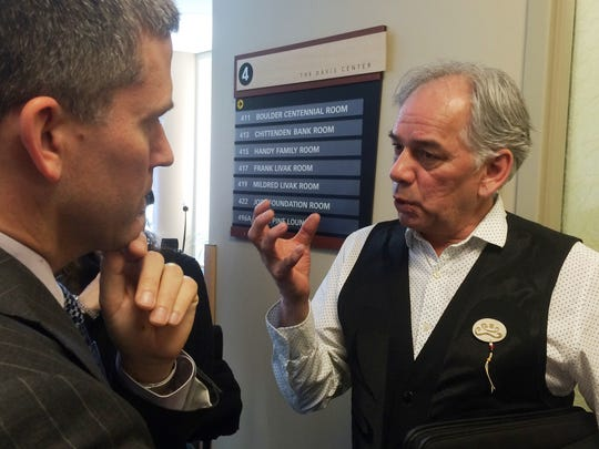 Ghislain Picard (at right), Chief of the Assembly of First Nations of Québec and Labrador, discusses wind energy with Peter Clibbon of Montréal-based RES Americas on Monday at UVM.