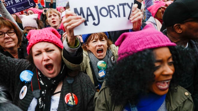 Protesters cheer at the Women's March on Washington during the first full day of Donald Trump's presidency, on Jan. 21, 2017, in Washington.