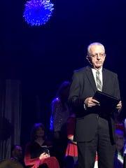 Emcee Larry McGraw kept Friday's Celebration Singers
