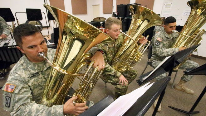 Sgt. Robert Tamargo, left, is part of the tuba section for the 1st Armored Division Band at Fort Blliss.