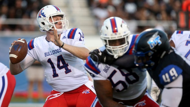 Louisiana Tech's quarterback Ryan Higgins (14) passes the ball against MTSU on Saturday, Sept. 23, 2016.