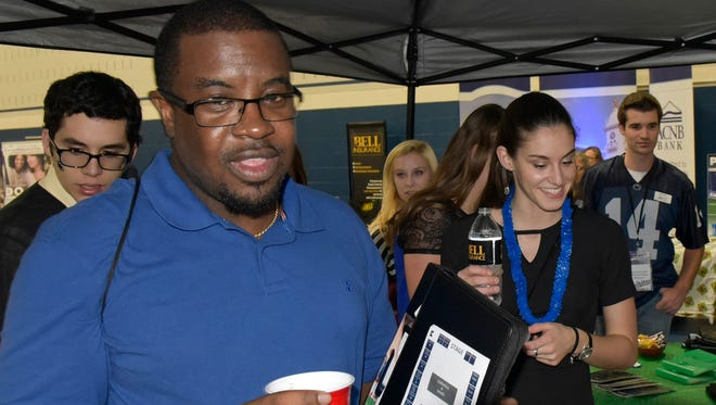 Darren Williams, Frederick, visits various vendors on Thursday, October 20, 2016 at the Chamber Business & Industry Expo at Penn State Mont Alto.