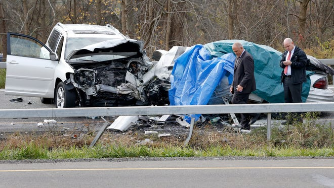 In a Nov. 2 photo, police investigate the crash site where Adam M. VanCise, 35, died after hitting a white SUV head on. The driver and passenger of the white SUV, Dianne Box and Maureen LoPresto are suing the Chemung County Sheriff's Office for negligence. Deputies initiated a high speed pursuit of VanCise from the Horseheads WalMart.