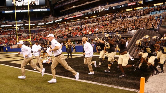 Purdue head coach Jeff Brohm leads the Boilermakers