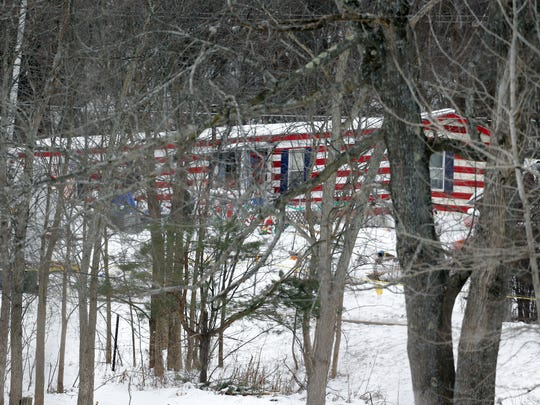 The home where a 5-year-old boy was abducted on Thursday is seen through trees on Friday, Dec. 19, 2014, in Berne, N.Y. Albany County Sheriff Craig Apple told local media at about 3 a.m. Friday that the body of Kenneth White was found by a sheriff's K-9 unit conducting a search in the rural hamlet of Clarksville, 10 miles southwest of Albany. No other details have been released.