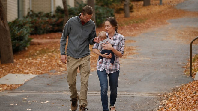 Spencer and Lauren Hanson walk near their home with daughter Lyla in Provo on Nov. 4, 2017. They have been married two years.
