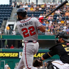 PITTSBURGH, PA - AUGUST 18:  Jason Heyward #22 of the Atlanta Braves hits a home run in the first inning against the Pittsburgh Pirates during the game at PNC Park on August 18, 2014 in Pittsburgh, Pennsylvania.