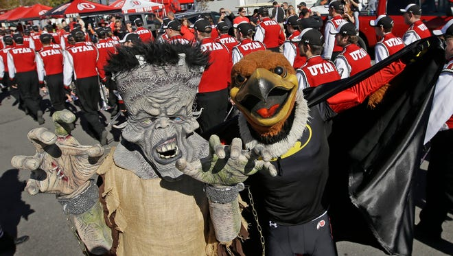 Brian Stephensen and the Utah mascot Swoop pose for a photograph while tailgating before the start of their NCAA college football game between Utah and Oregon State Saturday, Oct. 31, 2015, in Salt Lake City.
