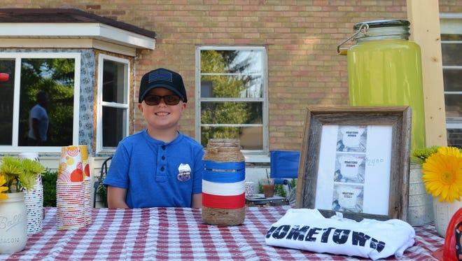 Michael McNabb, 7, raised money for Tri-Hospital EMS' Shop With a Hero program on July 8, 2018, in Lexington, Michigan.