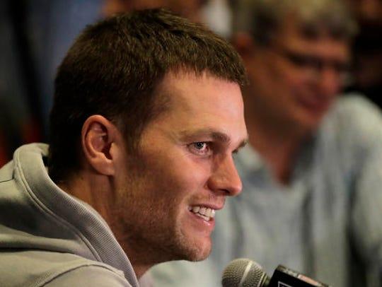 New England Patriots quarterback Tom Brady does an