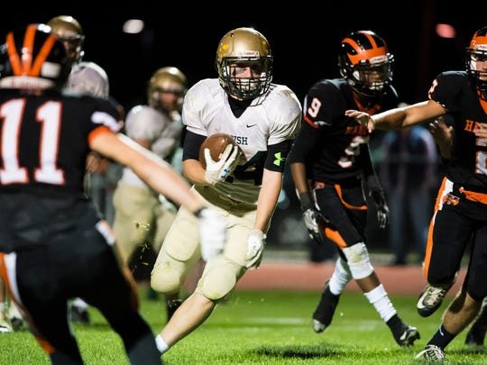 York Catholic's Andrew Snelbaker (24) runs the ball
