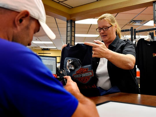 Tracy Boyd, of 1st Capital Harley-Davidson, rings up a t-shirt which sports the dealership's new logo, at the store in York, Pa. on Thursday, Aug. 20, 2015. The Manchester dealership, previously Laugerman's Harley-Davidson, began under its new ownership on Wednesday. Dawn J. Sagert - dsagert@yorkdispatch.com