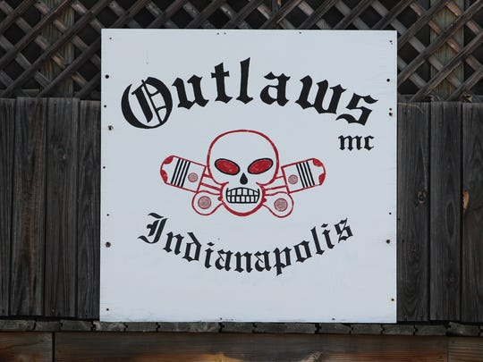 The Outlaws Motorcycle Club's sign was visible at the club's Eastside headquarters during the raid by law enforcement in July 2012.