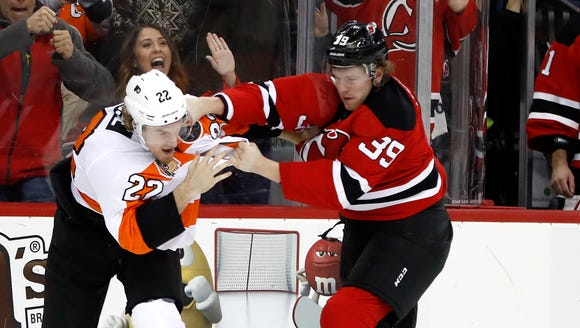 Philadelphia Flyers right wing Dale Weise, left, and