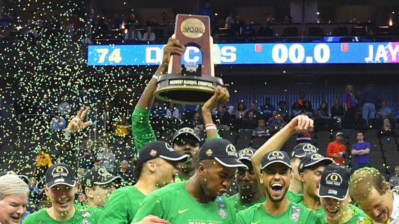 Mar 25, 2017; Kansas City, MO, USA; Oregon Ducks players celebrate with the trophy after the game against the Kansas Jayhawks in the finals of the Midwest Regional of the 2017 NCAA Tournament at Sprint Center. Oregon defeated Kansas 74-60. Mandatory Credit: Denny Medley-USA TODAY Sports