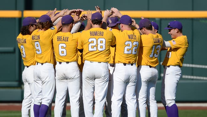 The LSU Tigers players huddles prior to their game against the Oregon State Beavers at TD Ameritrade Park Omaha.